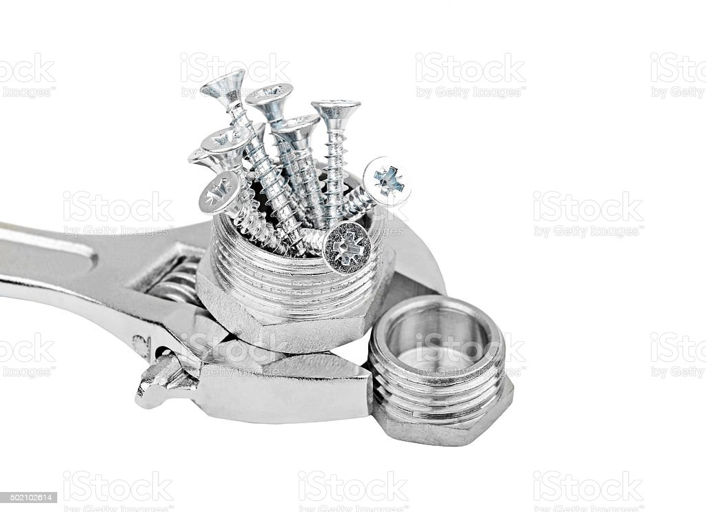 Wrench, plumbing fitting and screw stock photo