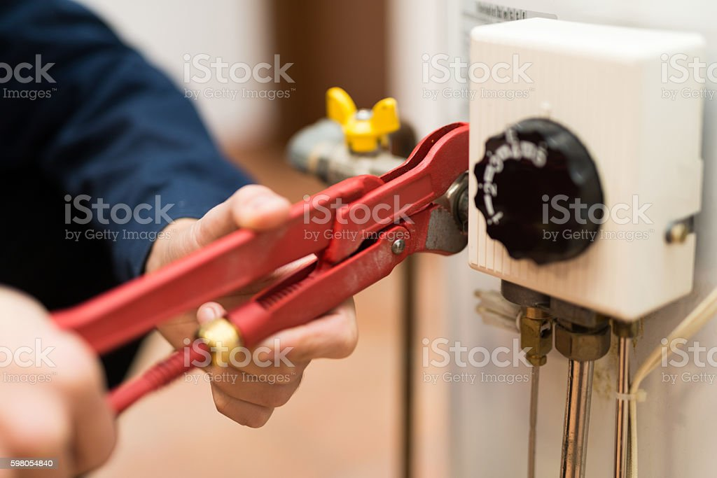 Wrench tighting up a fitting stock photo