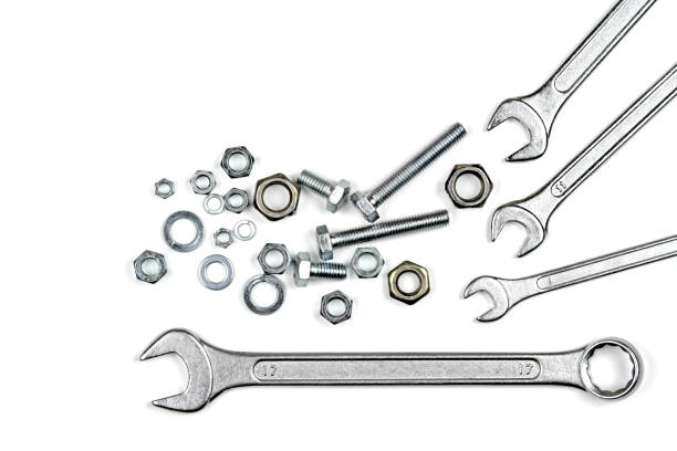 Wrenches, bolts and washers Wrenches, bolts and washers isolated on white background bolt fastener stock pictures, royalty-free photos & images