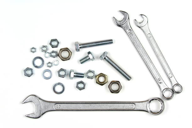 Wrenches, bolts and washers Wrenches, bolts and washers isolated on white background washer fastener stock pictures, royalty-free photos & images