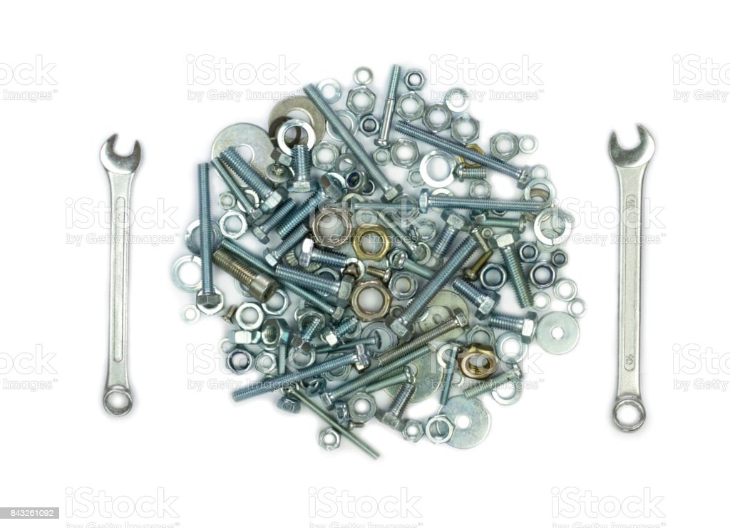 Wrenches, bolts, nuts, screws and washers . Conceptual image of fork and knife like  a meal stock photo
