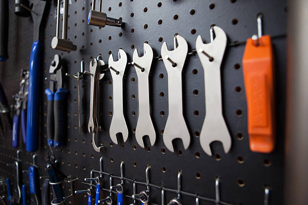 Wrenches hanging in a bicycle shop stock photo