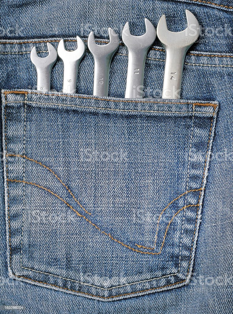 Wrenches in blue jeans pocket royalty-free stock photo