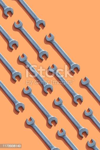 Wrenches on orange background