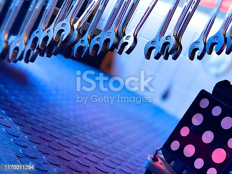 1155772265 istock photo Wrenches Spanners hanging in a workshop; Wheel alignment kit 1175011294