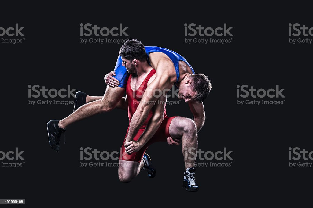 Wrestler performs a throw isolated stock photo
