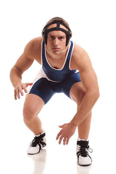 Wrestler Wrestler. Studio shot over white. greco roman style stock pictures, royalty-free photos & images
