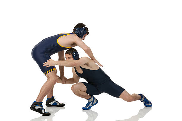 wrestlers in action - wrestling stock photos and pictures