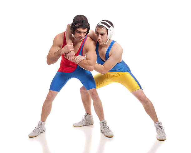Wrestlers Wrestling action. Studio shot over white. greco roman style stock pictures, royalty-free photos & images