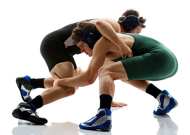 wrestlers wrestling - wrestling stock photos and pictures