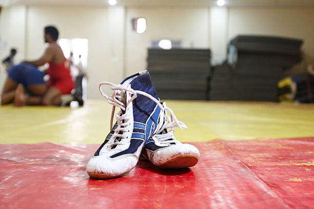 wrestling boots at the gym - wrestling stock photos and pictures