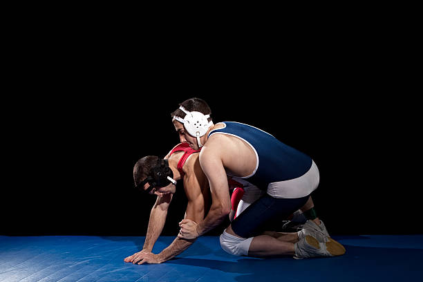 wrestling - wrestling stock pictures, royalty-free photos & images