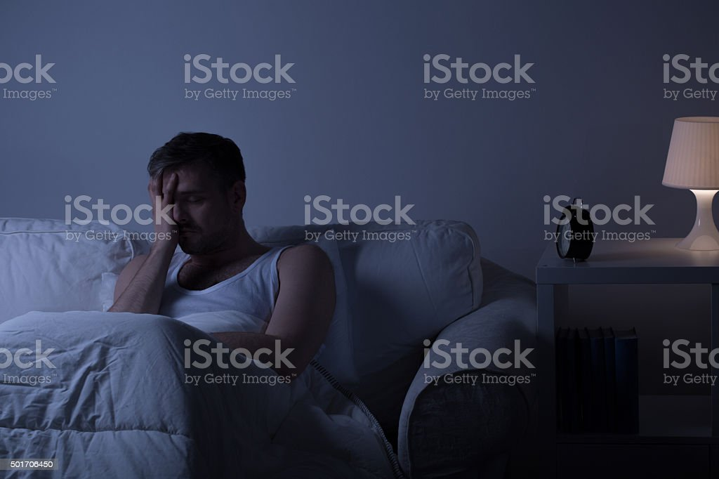 Wretched man suffering from depression stock photo