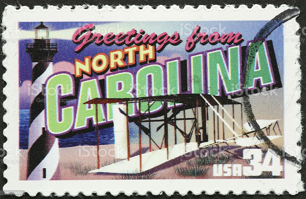 Wright flyer and lighthouse on North Carolna stamp stock photo