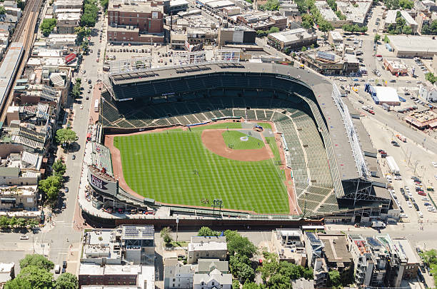 Wrigley Field stadium aerial view in chicago Chicago, Illinois, USA - July 12, 2013: Aerial view of the Wrigley Field stadium in chicago. This arena is the house of the Chicago Cubs baseball team. The stadium is situated on the North East downtown of Chicago. The image has been taken from an Helicopter . major league baseball stock pictures, royalty-free photos & images