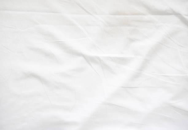 wrinkle on white bed sheet - sheet imagens e fotografias de stock