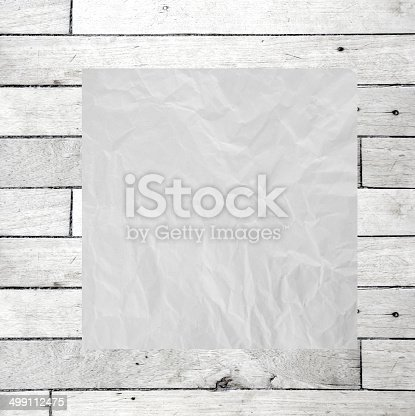 istock Wrinkle recycle paper on wood board. 499112475