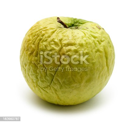 Wrinkled apple, concept ageing, dry skin, passing of time, past your prime etc