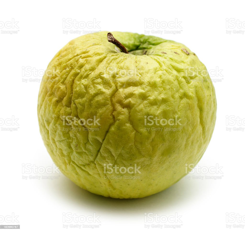 Wrinkled apple, concept ageing, dry skin stock photo
