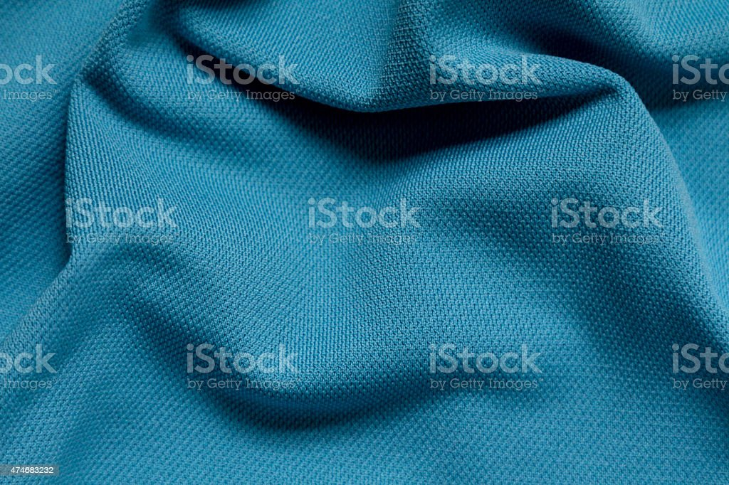 Wrinkled blue polyester sport fabric, full frame stock photo