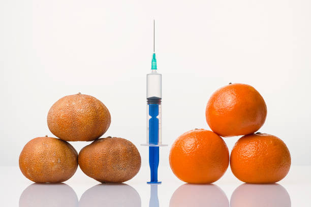 Cтоковое фото Wrinkled dried and smooth elastic tangerines the syringe
