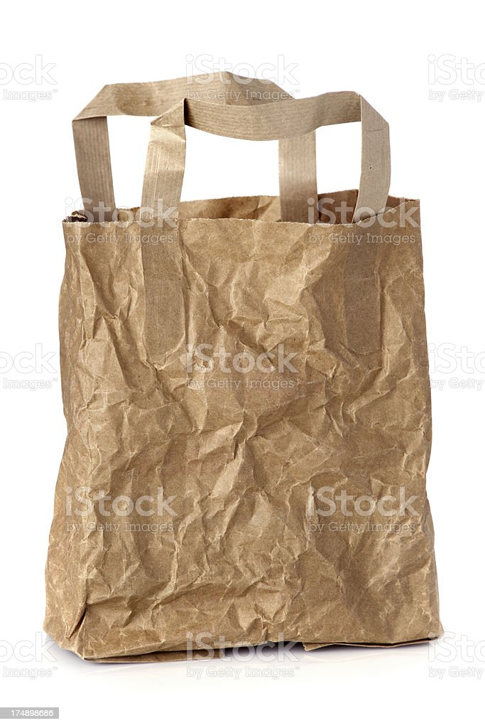 Wrinkled empty brown paper lunch bag stock photo