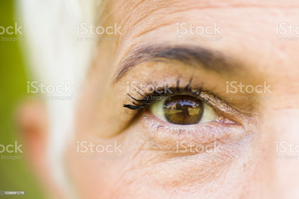 Close up view at wrinkled eye of beautiful lady