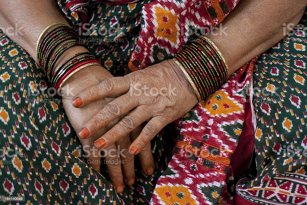 Wrinkled indian woman hands stock photo