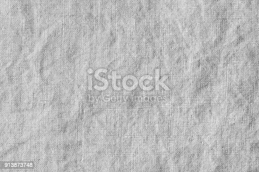 istock wrinkled, natural linen texture 913873748