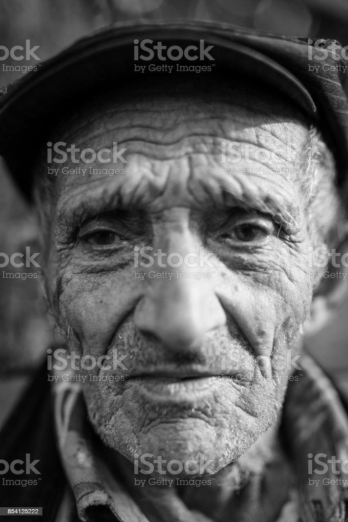 Wrinkled old man stock photo