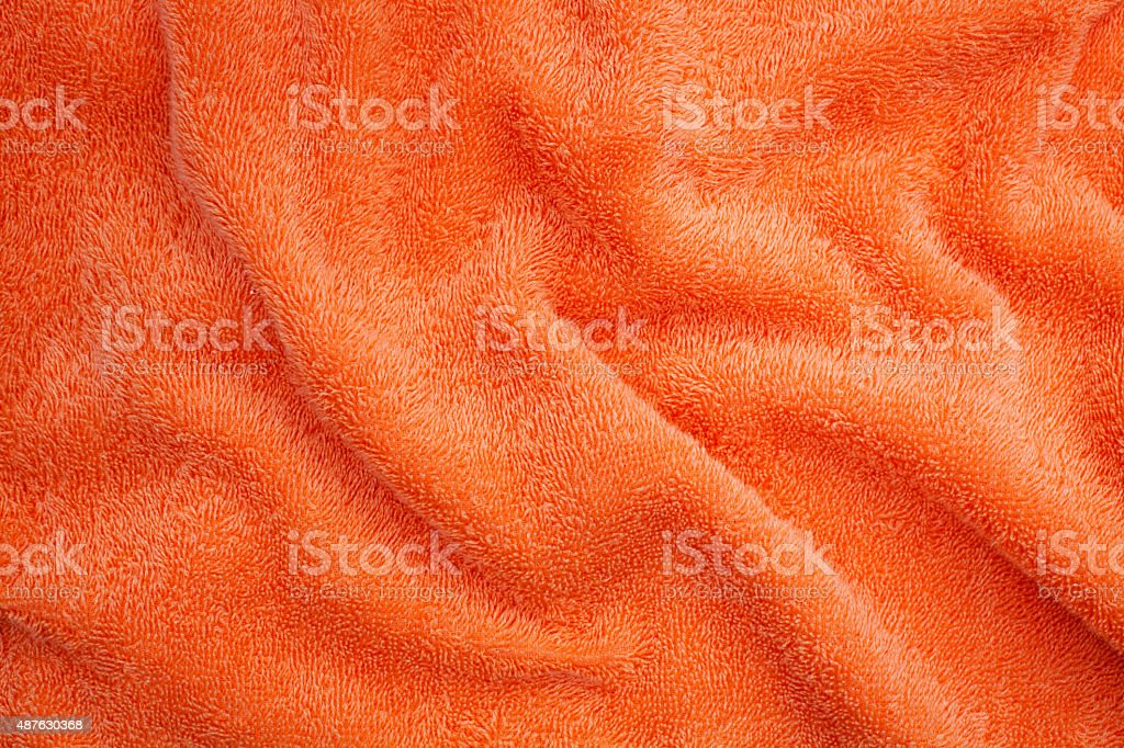 Wrinkled orange blanket stock photo