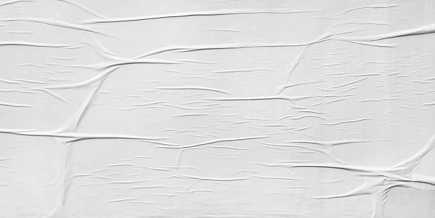 wrinkled paper glued on wall texture - paper stockfoto's en -beelden