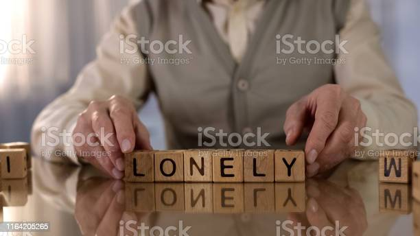 Wrinkled pensioner making word lonely of wooden cubes on table home picture id1164205265?b=1&k=6&m=1164205265&s=612x612&h=kq kj oqnolrcrkxlqy7xsvbu dir0qzoi7yjuiuaos=