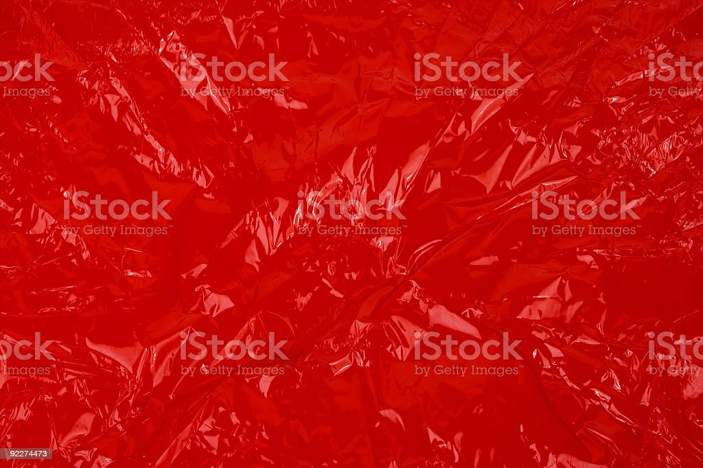 Wrinkled Red Cellophane Background. stock photo
