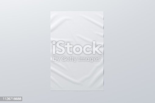 Blank vertical wrinkled street poster on white wall. With clipping path around poster. 3d illustration