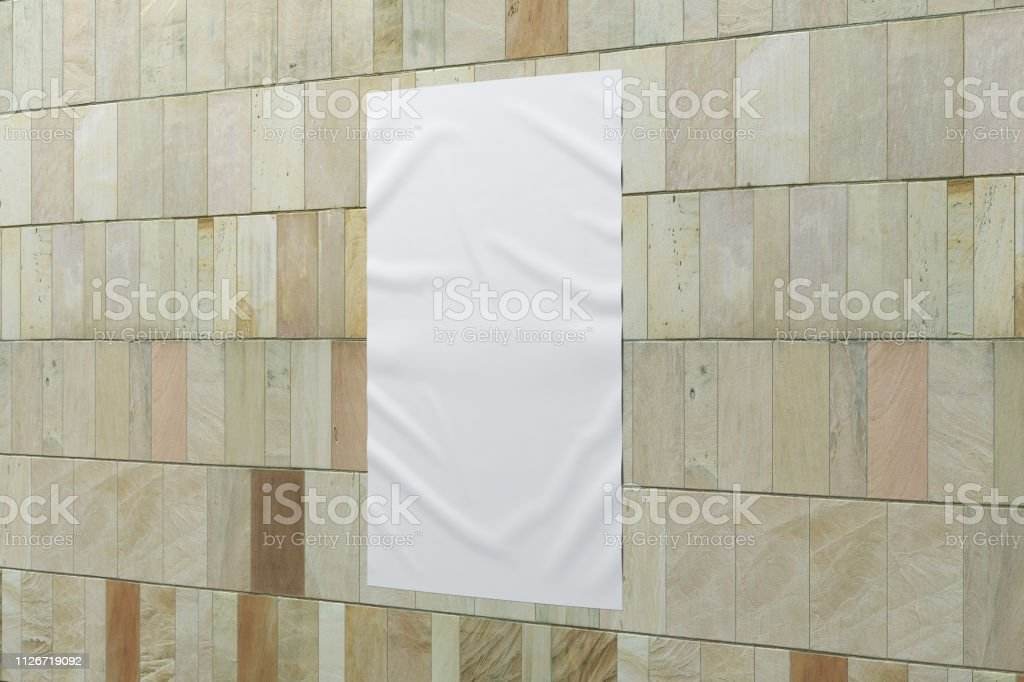 Blank vertical wrinkled street poster on marble tiles wall. With...