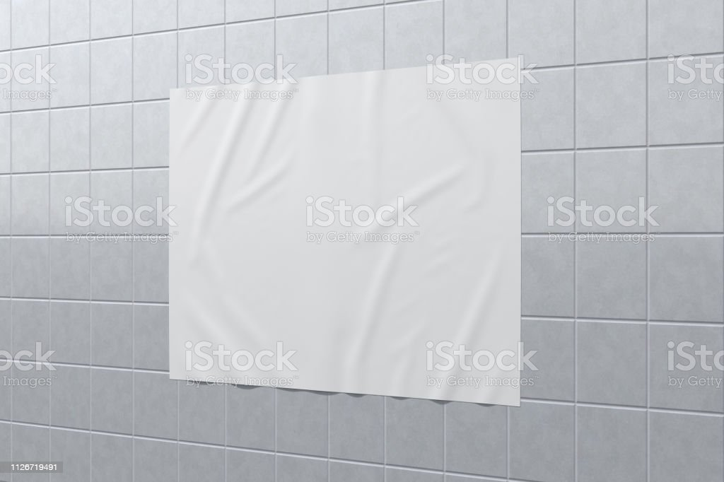 Blank horizontal wrinkled street poster on glazed tiles wall. With...