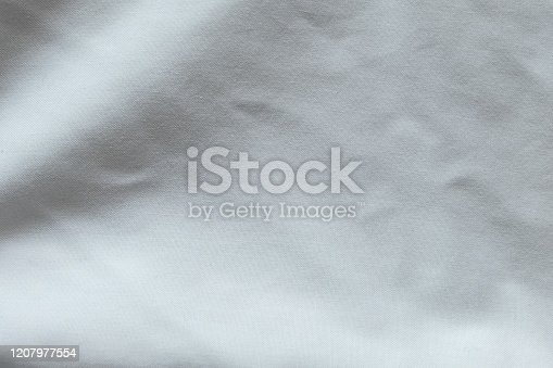 1164401366 istock photo Wrinkled White fabric close up shot of good quality Cotton and polyester shirt. formal wear for office worker . Background texture concept with copy space for text. 1207977554