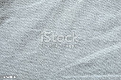 1164401366 istock photo Wrinkled White fabric close up shot of good quality Cotton and polyester shirt. formal wear for office worker . Background texture concept with copy space for text. 1210788167