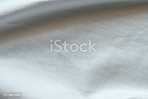 1164401366 istock photo Wrinkled White fabric close up shot of good quality Cotton and polyester shirt. formal wear for office worker . Background texture concept with copy space for text. 1212951833