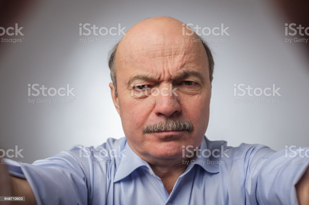 Wrinkles on the forehead of negative events stock photo