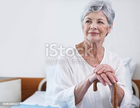 Shot of a senior woman leaning on her wooden walking stick