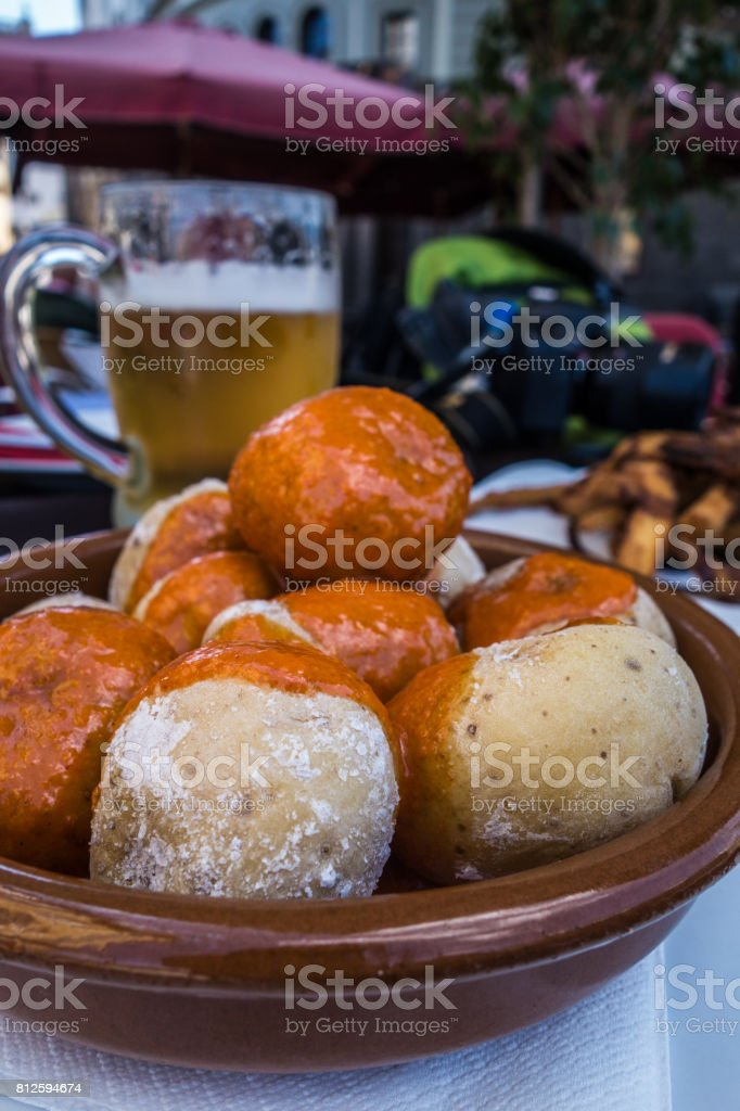 Wrinkly potatoes with red mojo stock photo