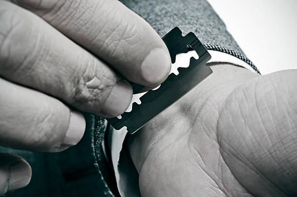 wrist cutting stock photo