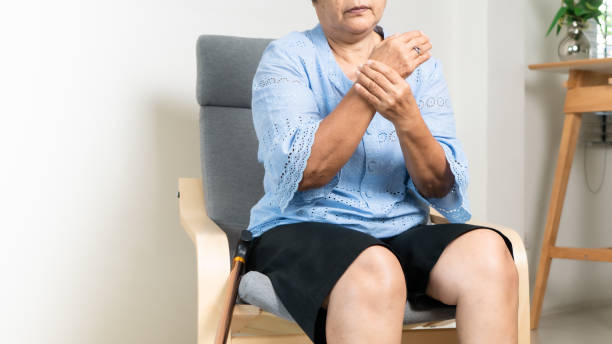 wrist hand pain of old woman, healthcare problem of senior concept stock photo
