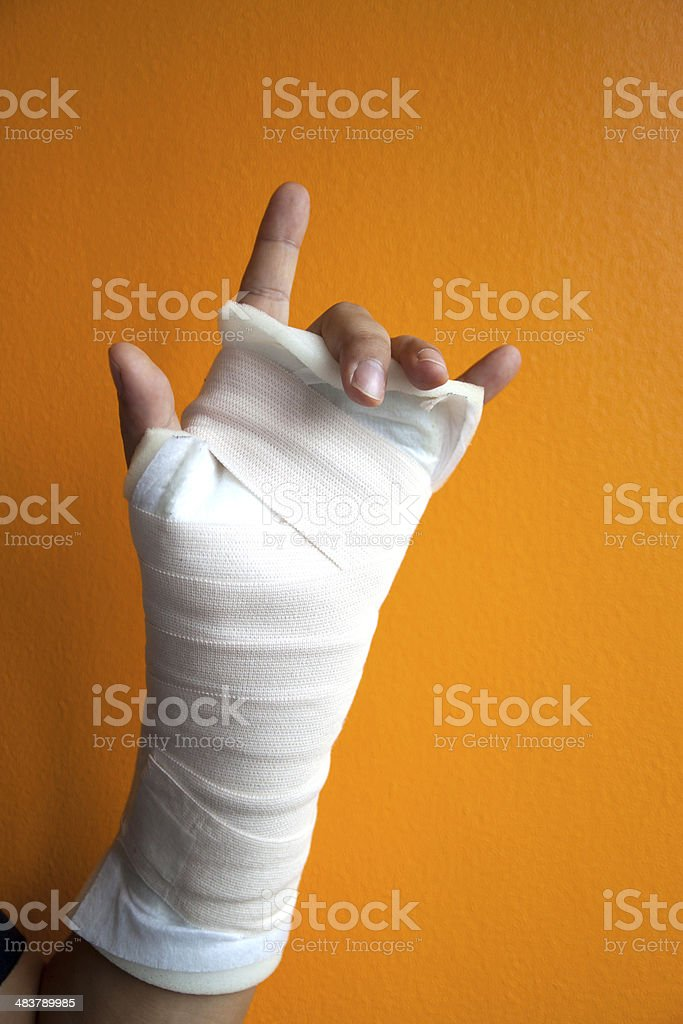 Wrist injury isolated on orange background stock photo