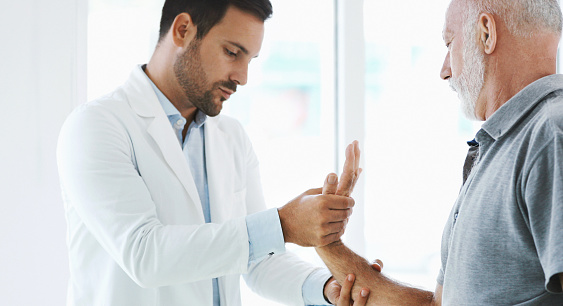 istock Wrist pain examination. 855557166