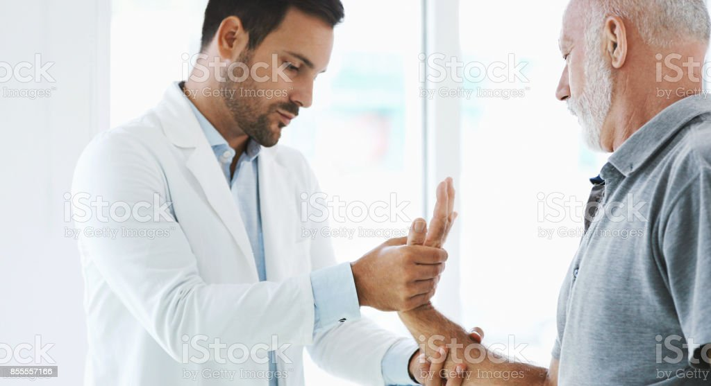 Wrist pain examination. stock photo