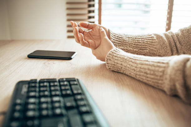Wrist pain from using computer and smartphone stock photo