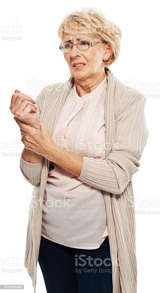 Wrist pain Senior woman massaging her wrist. Studio shot, white background. 60-69 Years Stock Photo